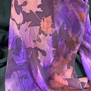 Oak leaf motif scarf in earthy orange and purple by