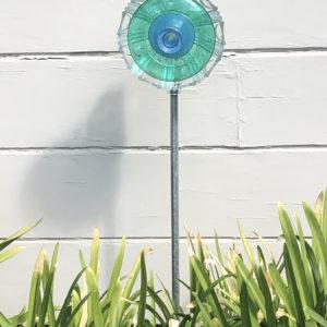 Blue green glass flower by